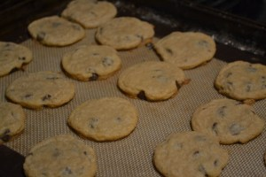 freshly baked chocolate chip cookies on silpat