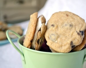 chocolate chip cream filled cookies in a green decorative bucket