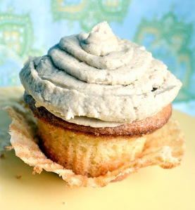 cupcakes with pumpkin filling and brown sugar frosting